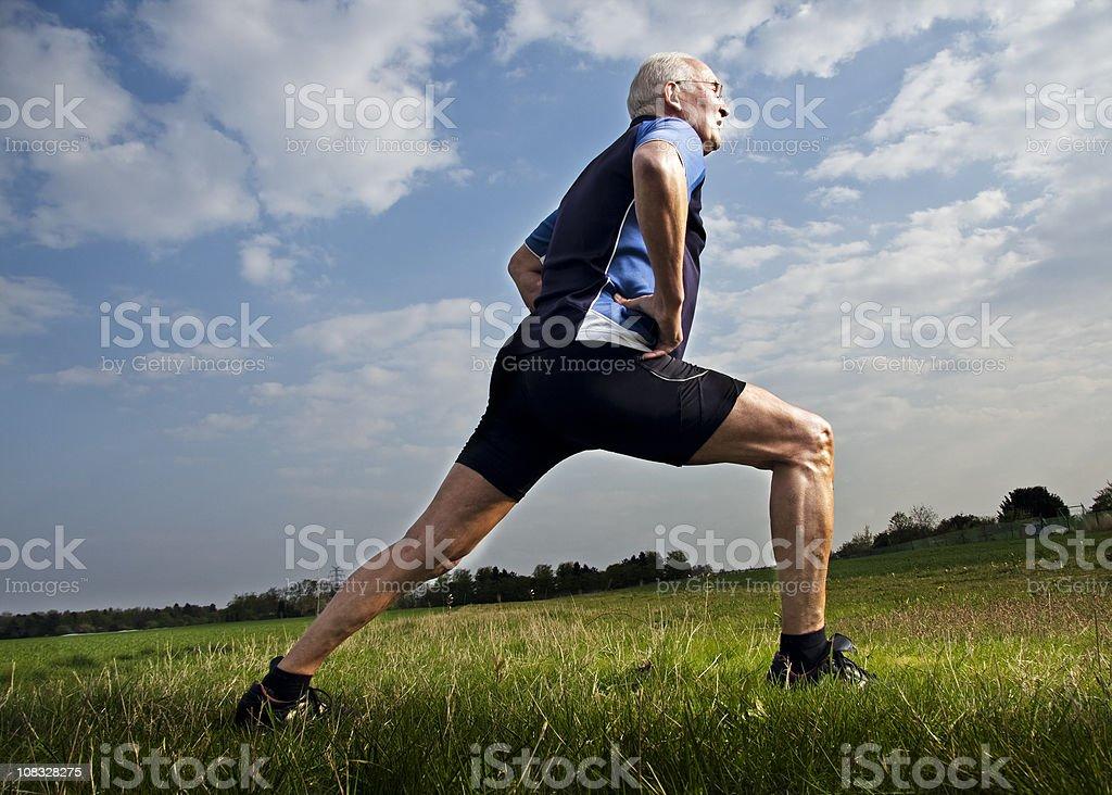 Active Senior Male Stretching stock photo