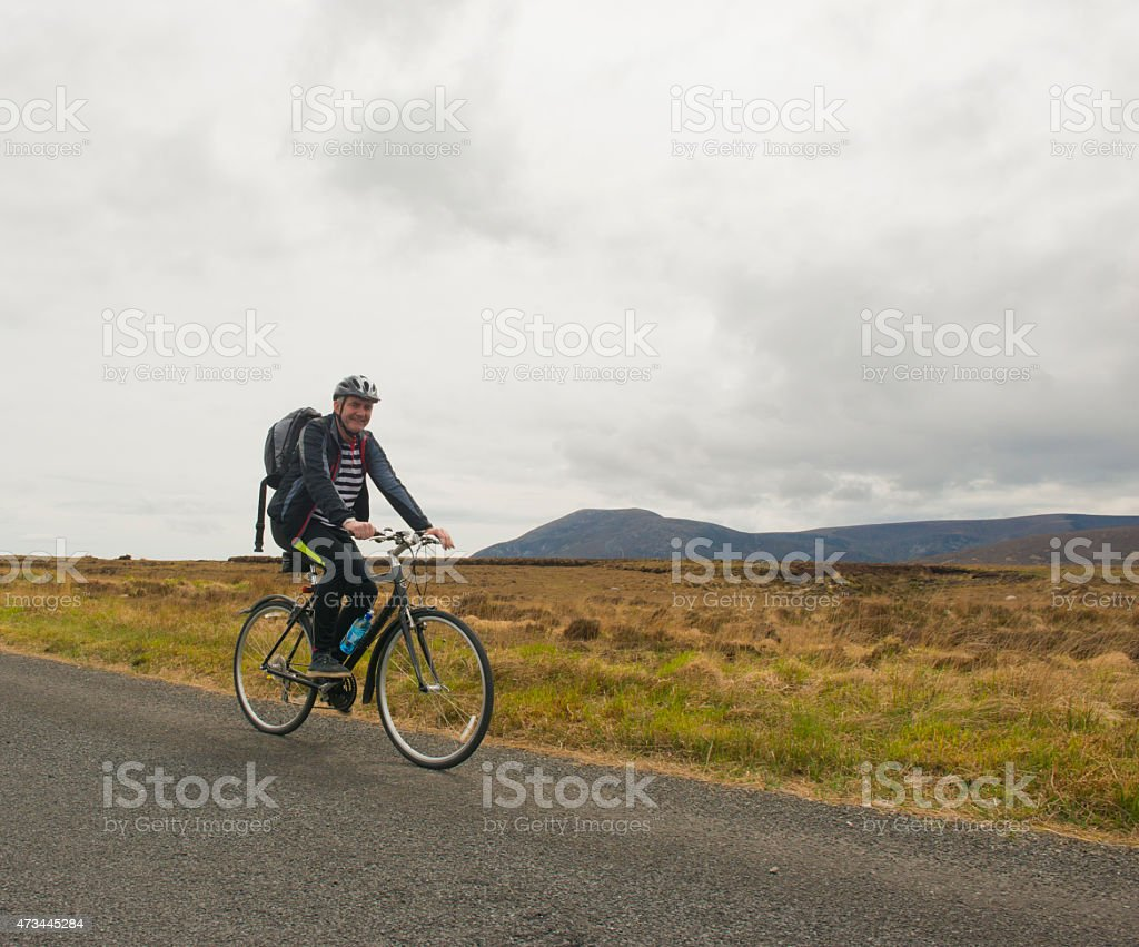Active senior man cycling in nature stock photo