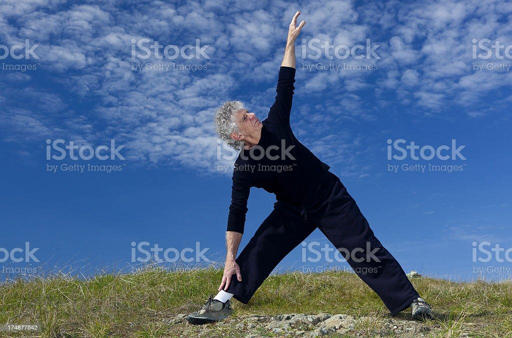 active senior man doing yoga royalty-free stock photo