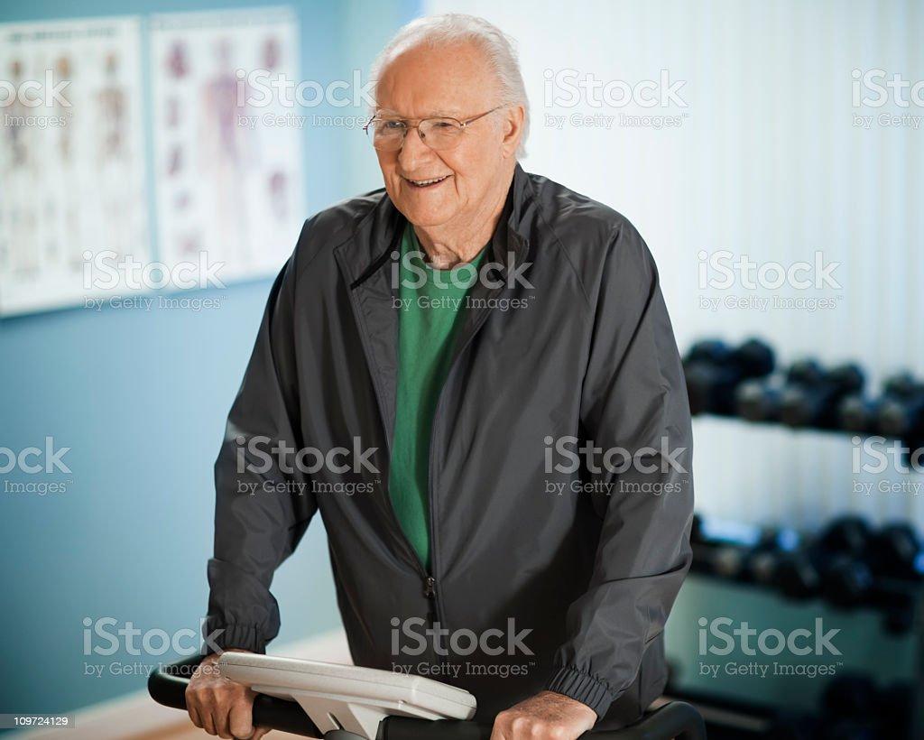 Active Senior Man Exercising stock photo