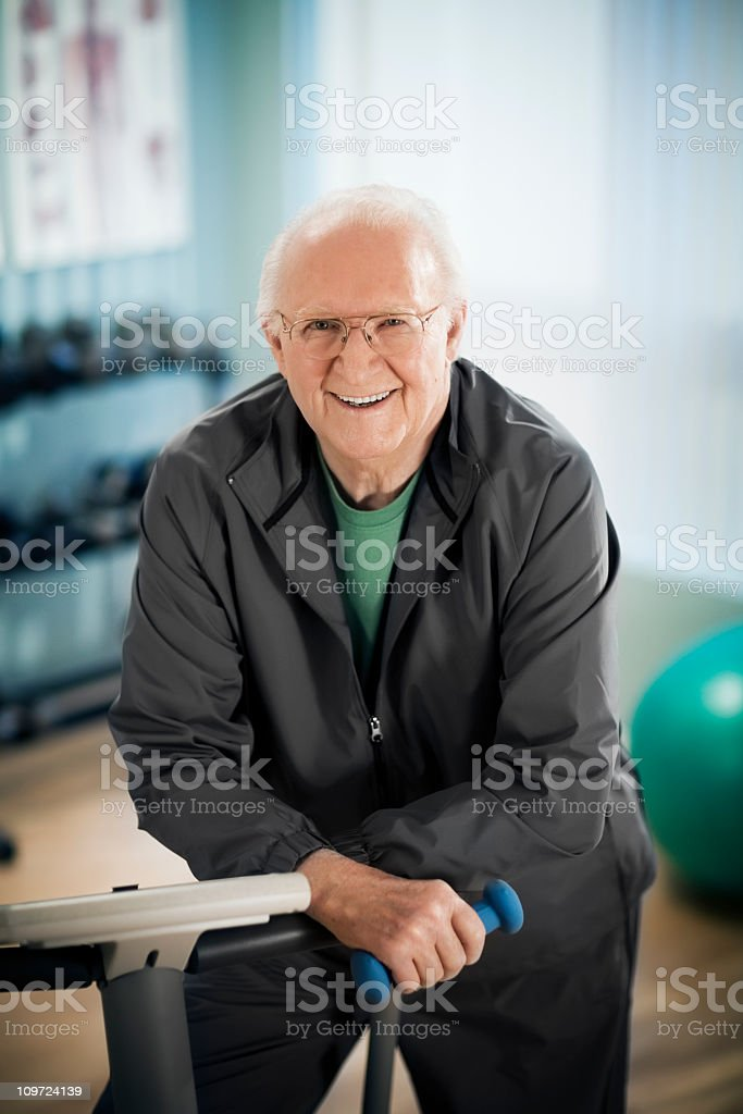 Active Senior man in Gym stock photo