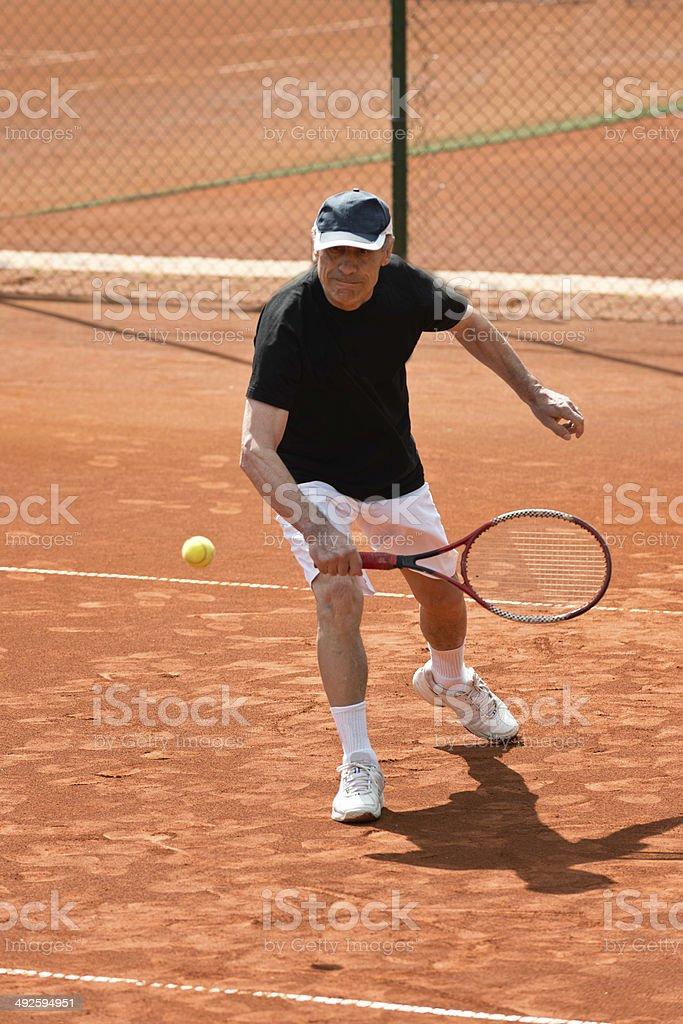 Active senior man playing tennis royalty-free stock photo