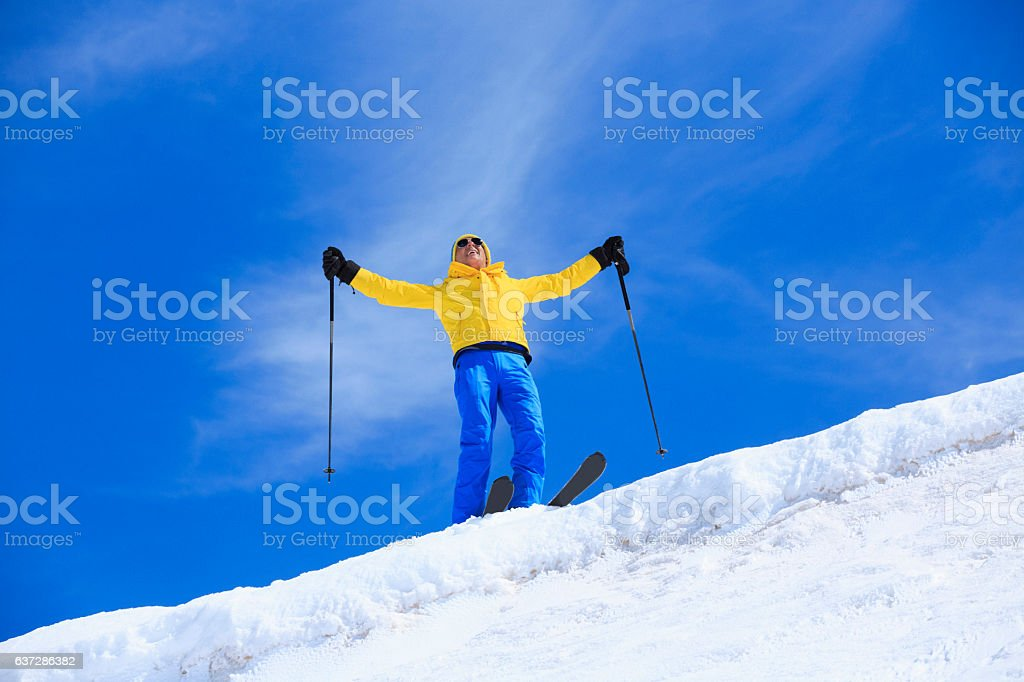 Active senior men snow skier  resting at the top stock photo