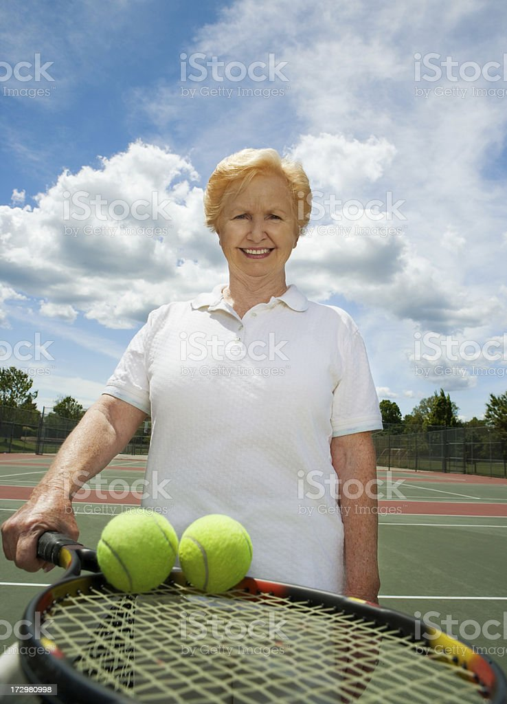 active senior on tennis court royalty-free stock photo
