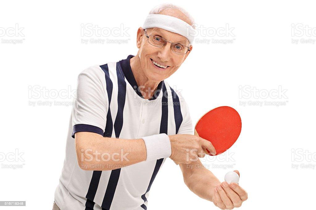 Active senior playing ping-pong stock photo