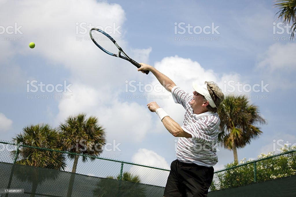 active senior playing tennis royalty-free stock photo