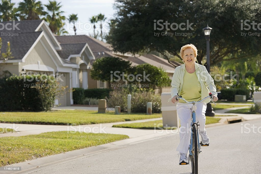 active senior riding Bicycle royalty-free stock photo