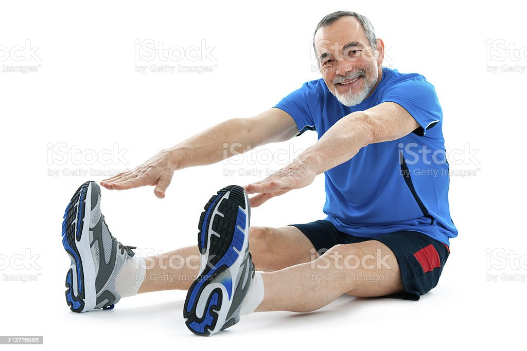 Active senior stretching and trying to reach his toes stock photo