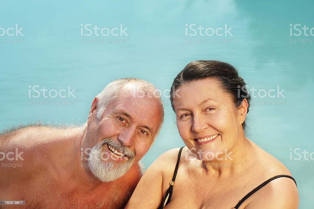 Active senior swimming couple royalty-free stock photo