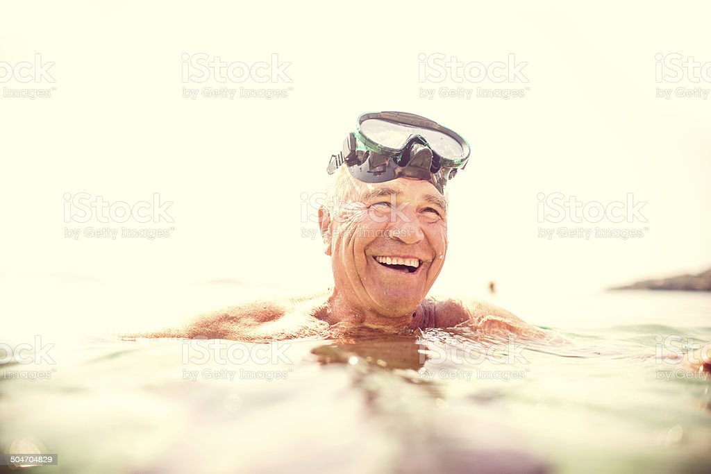 Active senior swimming stock photo