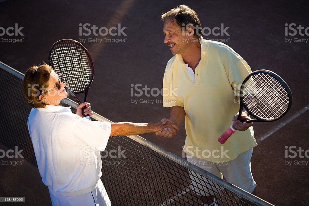 Active senior tennis partners royalty-free stock photo