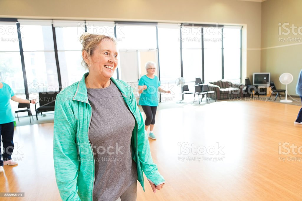 Active senior woman enjoying dance lessons stock photo