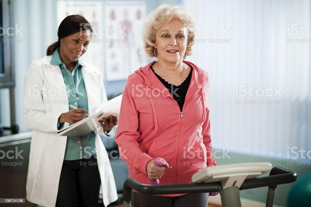 Active Senior Woman Exercising on Treadmill stock photo