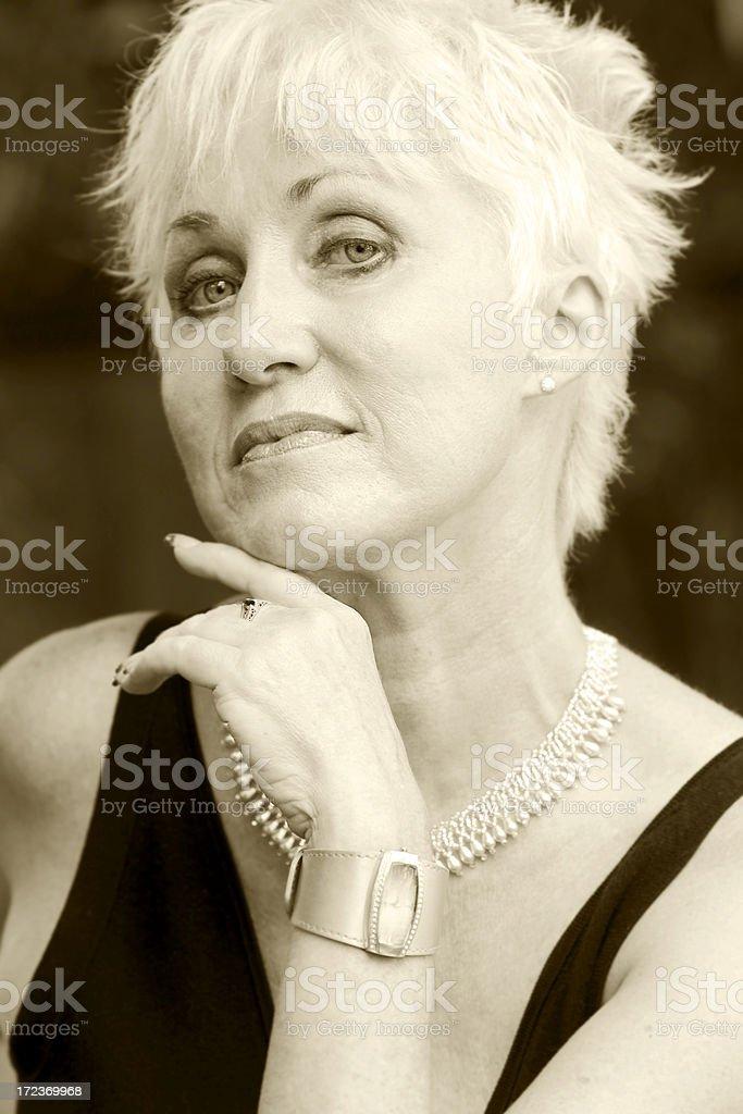 Active Senior Woman Portrait Posing as Cougar, Sepia Toned royalty-free stock photo