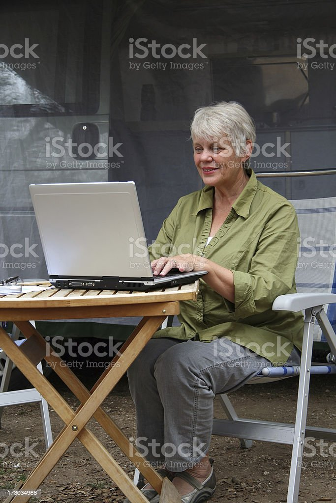 Active senior woman with laptop royalty-free stock photo