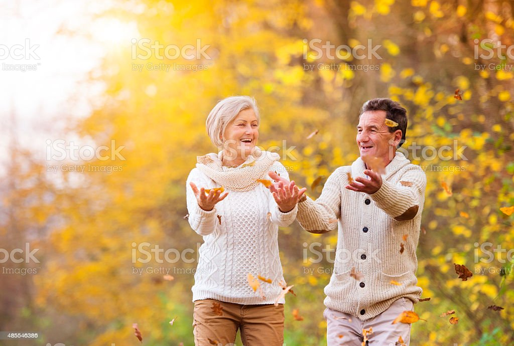Active seniors having fun in nature stock photo