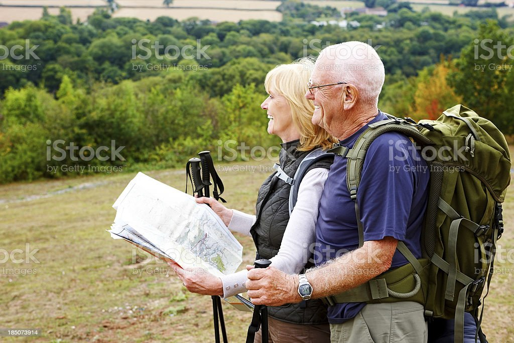 Active seniors hiking in countryside royalty-free stock photo