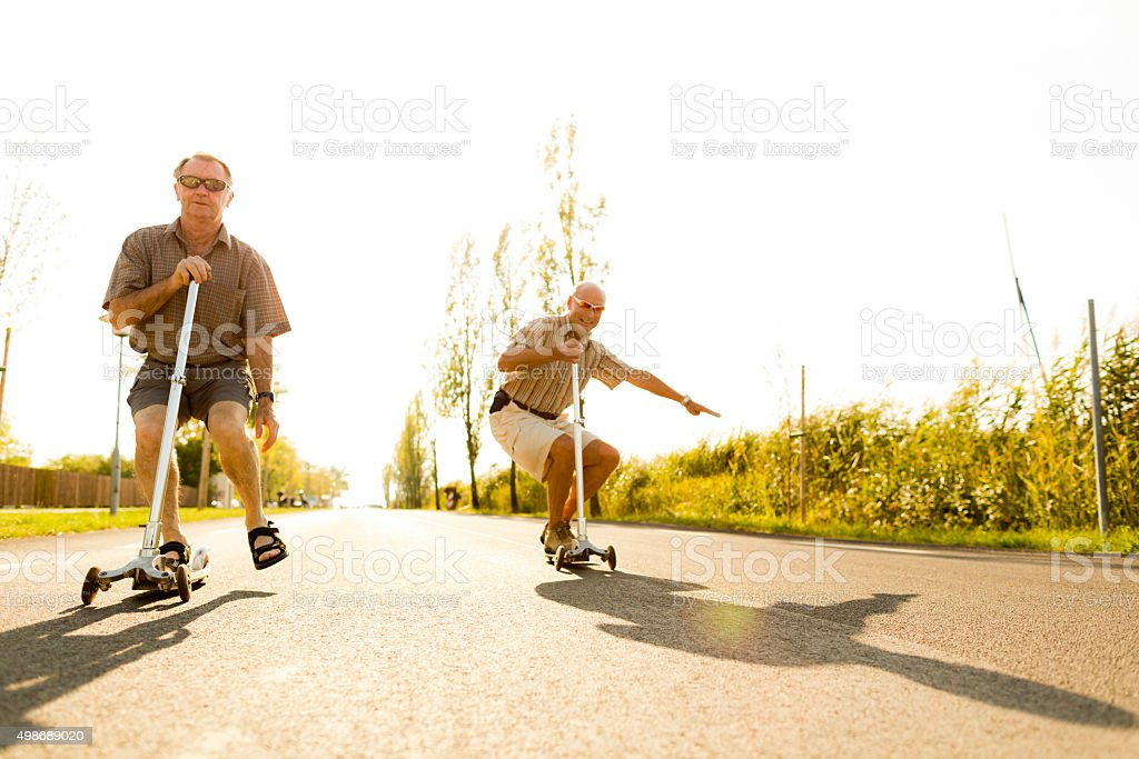 active seniors on kickboards stock photo