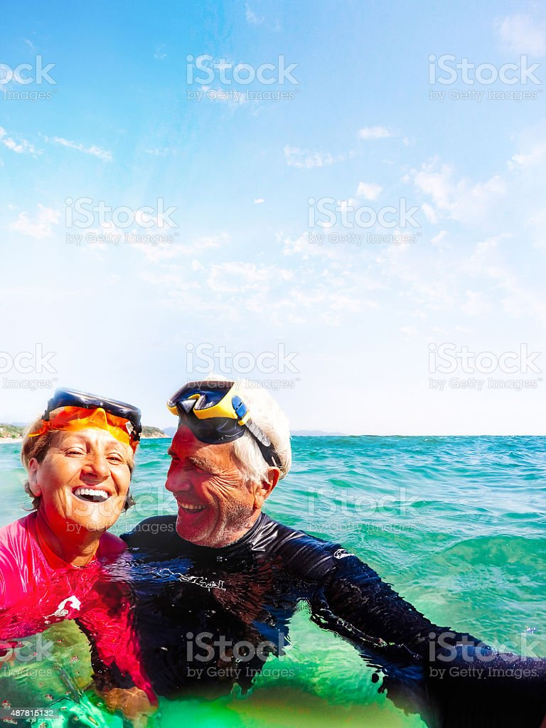 Active seniors snorkelling stock photo