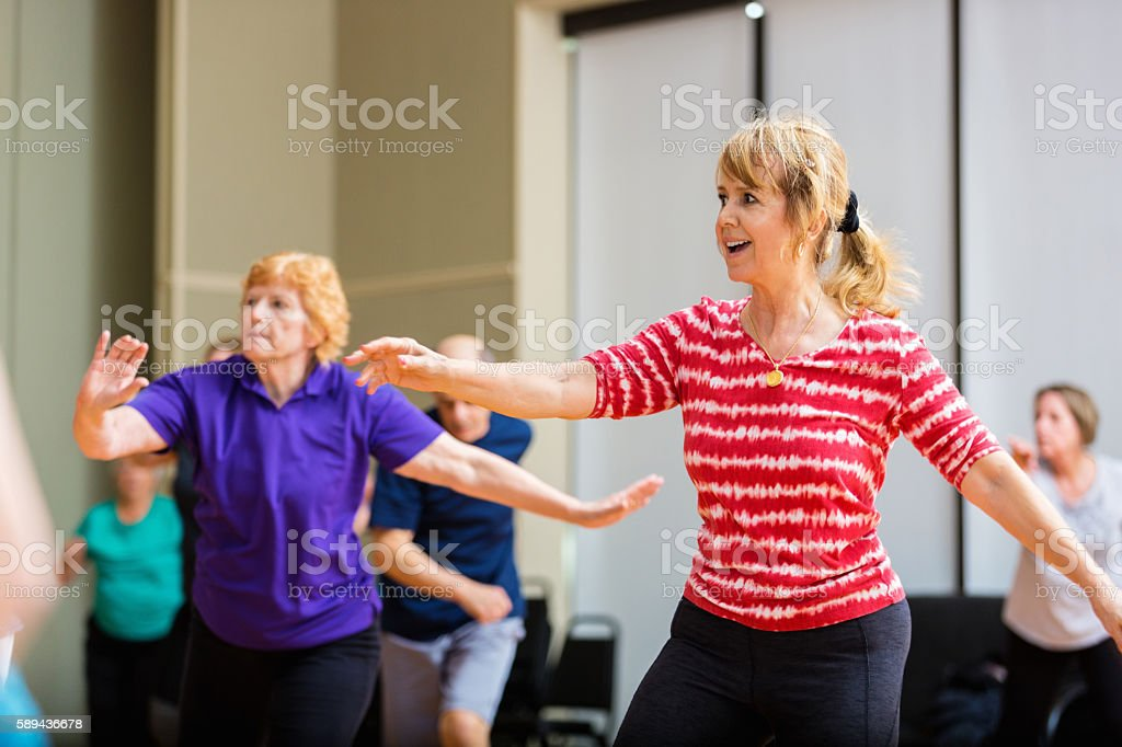 Active seniors take dance lessons at senior center stock photo