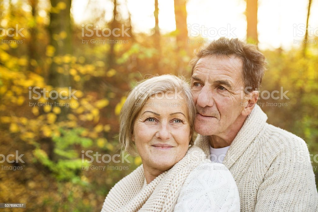Active seniors taking walk in nature stock photo