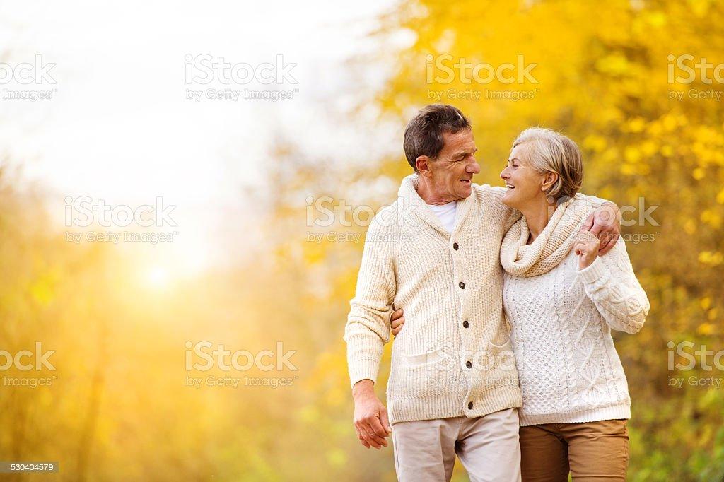 Active seniors walk in nature stock photo