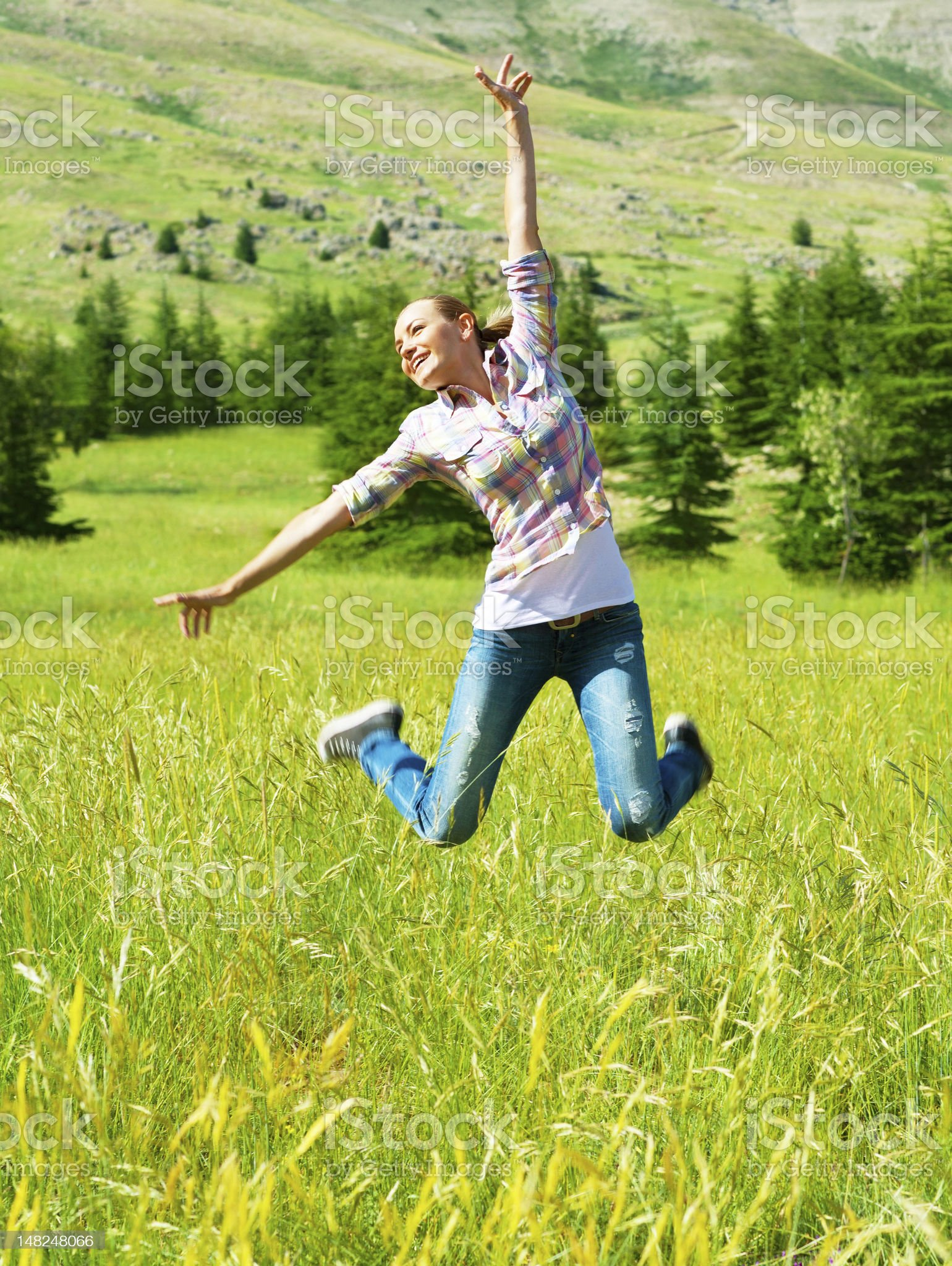 Active sporty woman jumping outdoors royalty-free stock photo