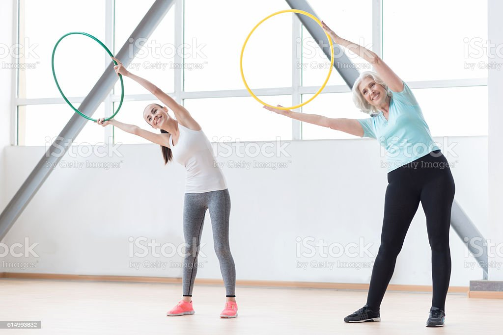 Active sporty women working out using sports equipment stock photo