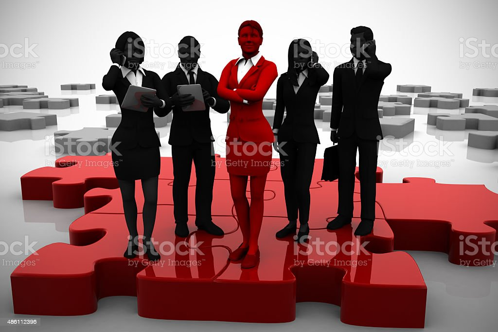 Active team of executives on Jigsaw puzzle. stock photo
