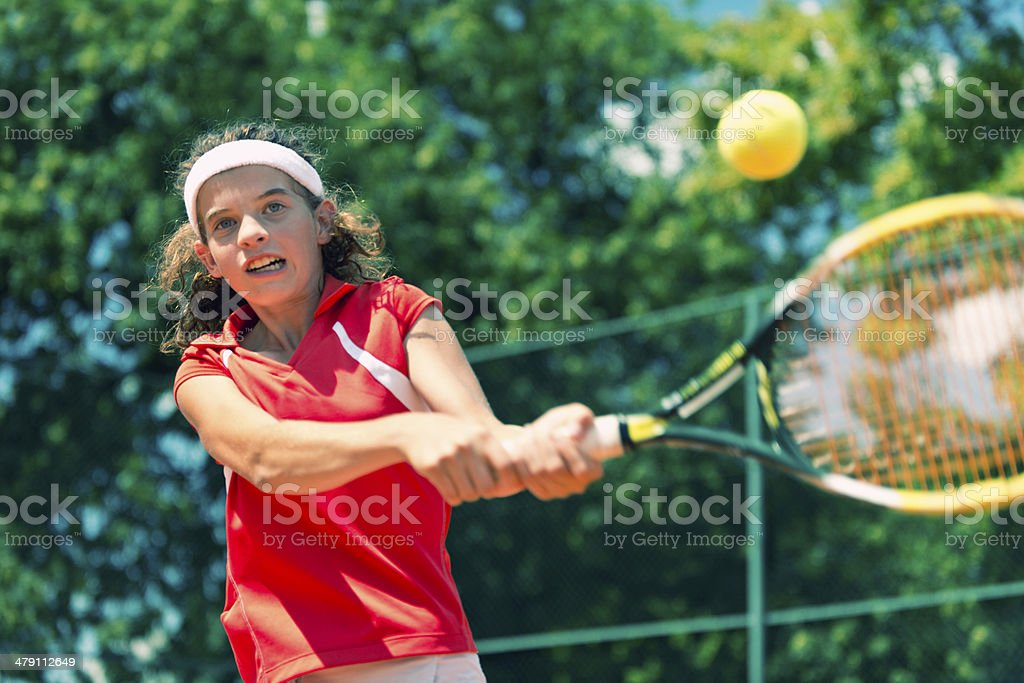 Active two-handed backhand royalty-free stock photo