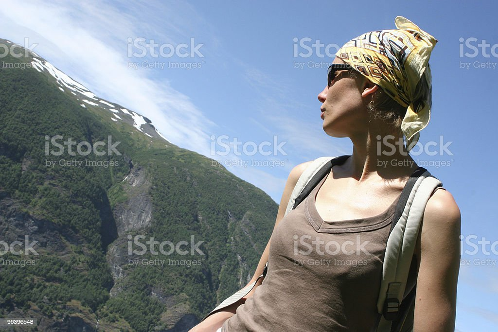 Active woman in headscarf on the mountain route royalty-free stock photo