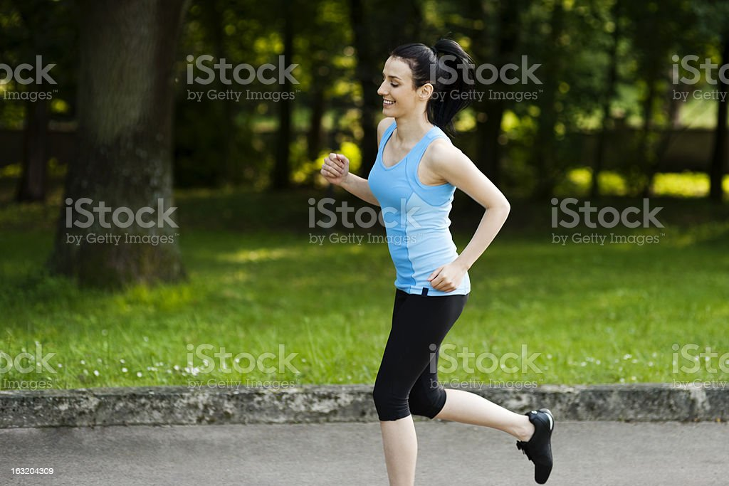 Active woman jogging royalty-free stock photo