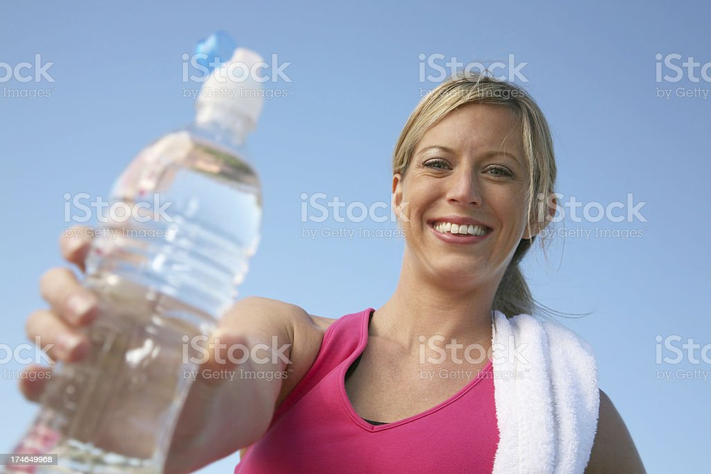 Active woman offering a bottle royalty-free stock photo