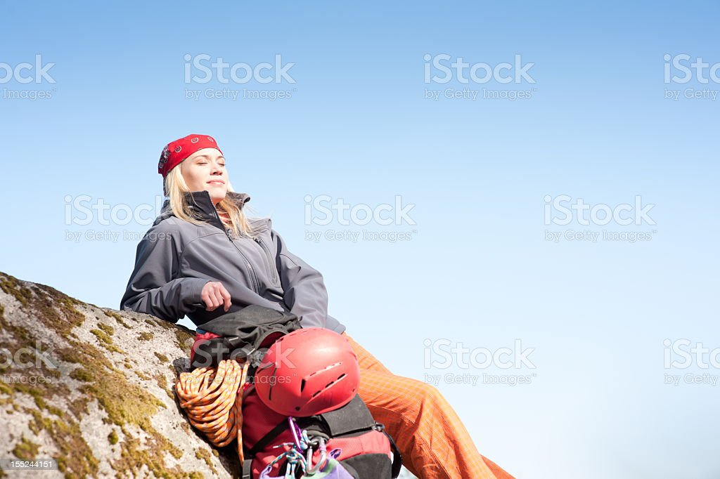 Active woman rock climbing relax with backpack royalty-free stock photo