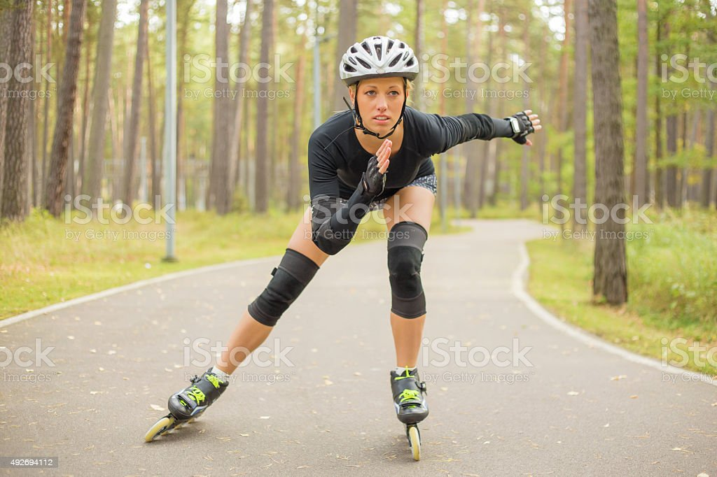 Active woman roller skating stock photo