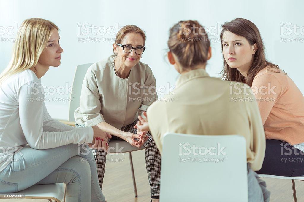 Active women on meeting stock photo