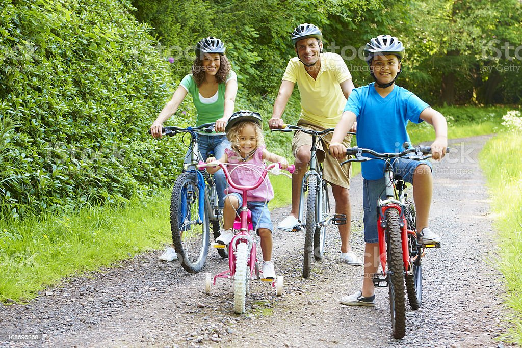 Active young family enjoying bike ride in the country royalty-free stock photo