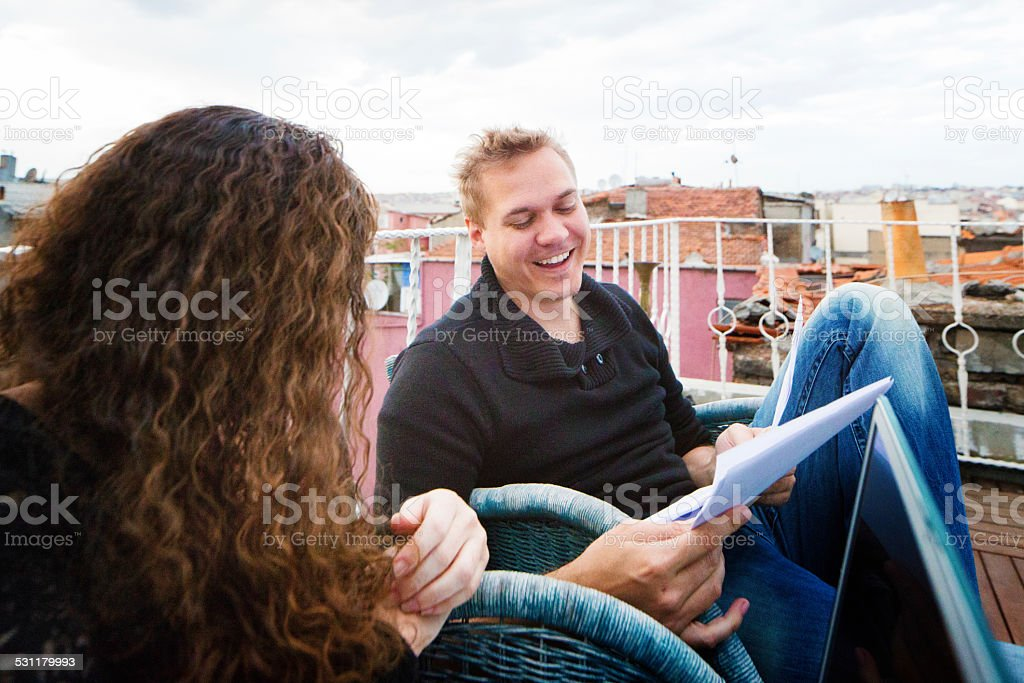 Actor enjoying script revisions on rooftop set during rehearsals stock photo