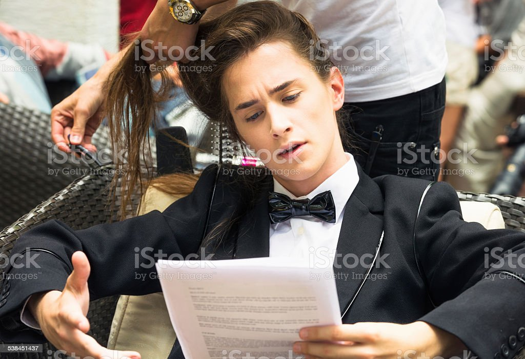 Actor practising script backstage stock photo