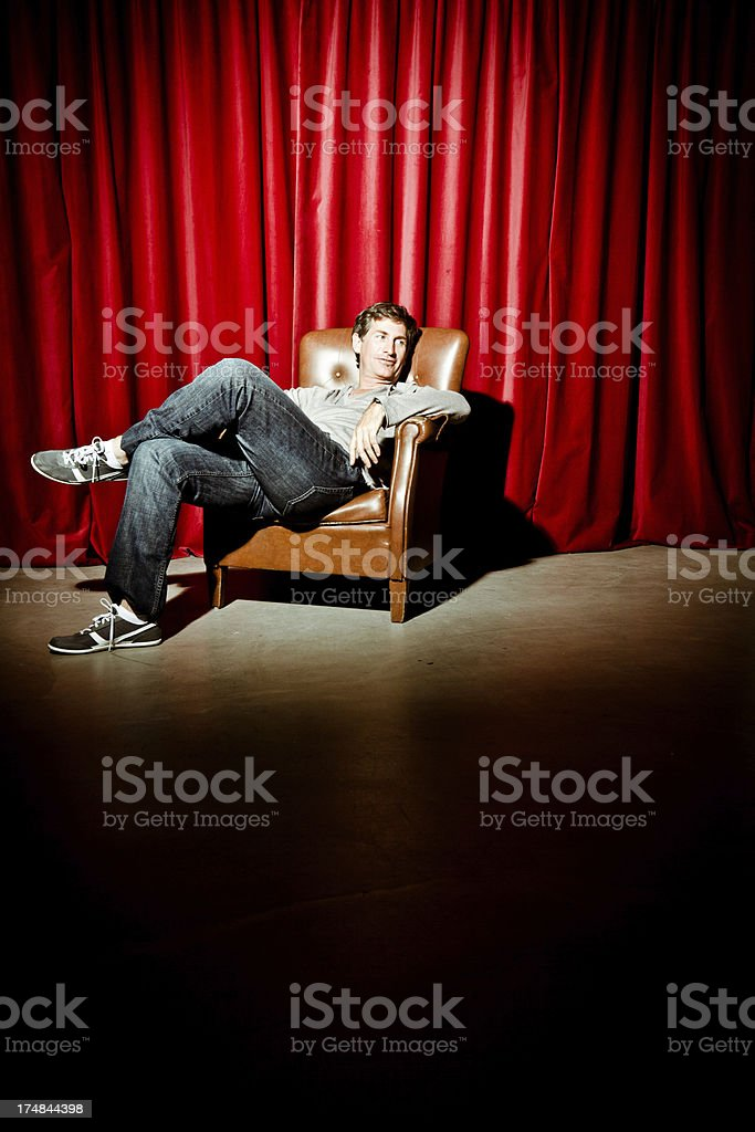 Actor sitting on an armchair royalty-free stock photo