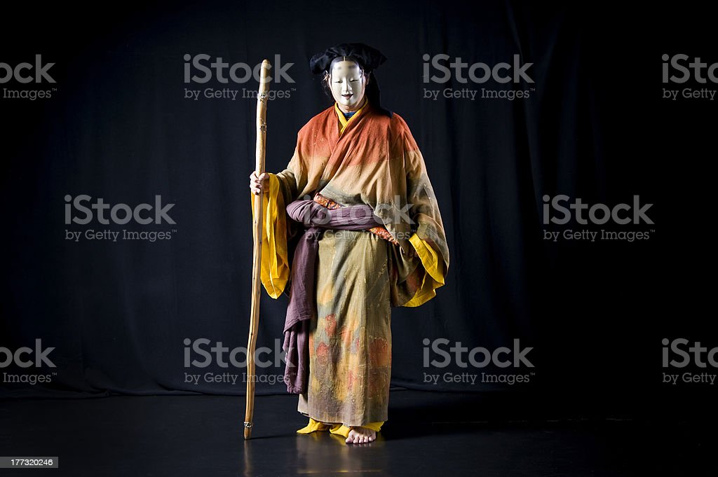 Actor wears Kimono and Noh Mask stock photo