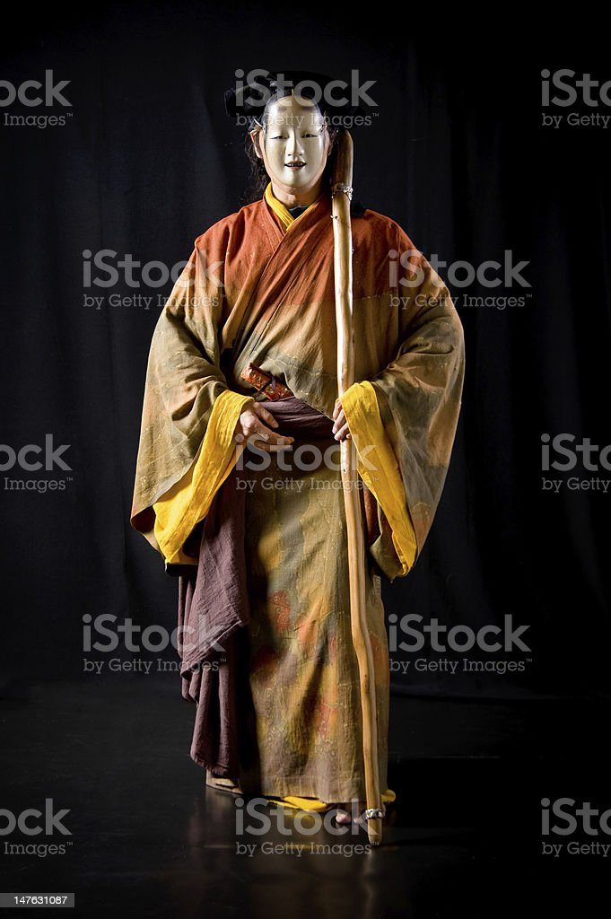 Actor wears Noh Mask stock photo