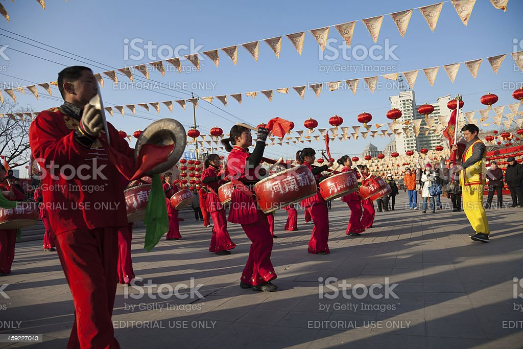 Actors beat drums and strike gongs stock photo