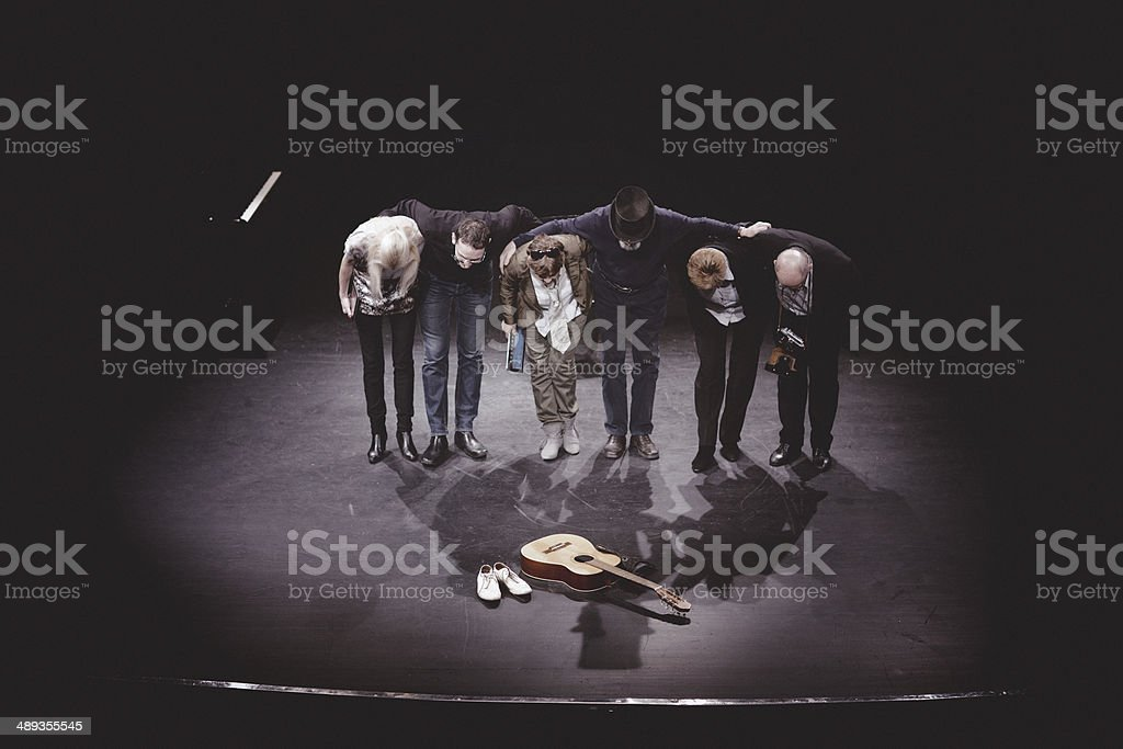 actors bow to thank the audience stock photo