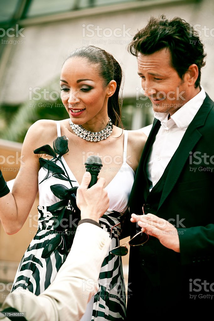 Actors on red carpet interviewed by journalist stock photo