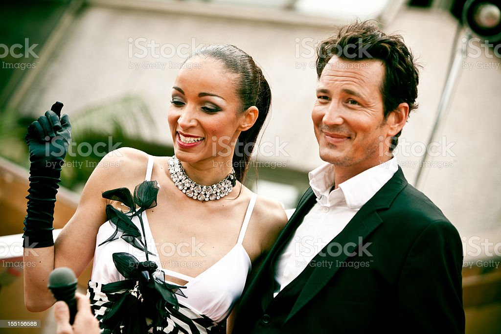 actors on red carpet interviewed royalty-free stock photo