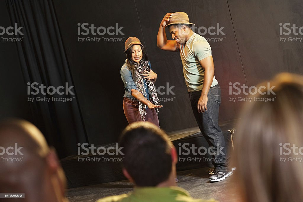 Actors on stage performing in front of audience stock photo