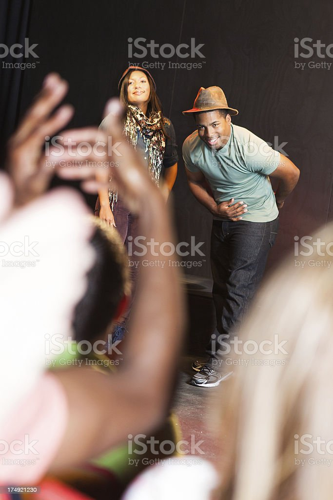 Actors taking a bow on stage after performance royalty-free stock photo