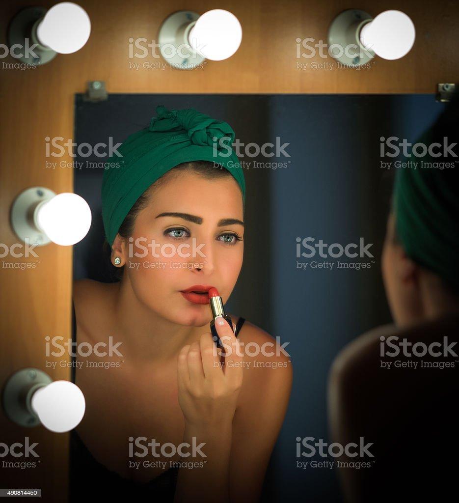 Actress Applies Makeup Backstage stock photo