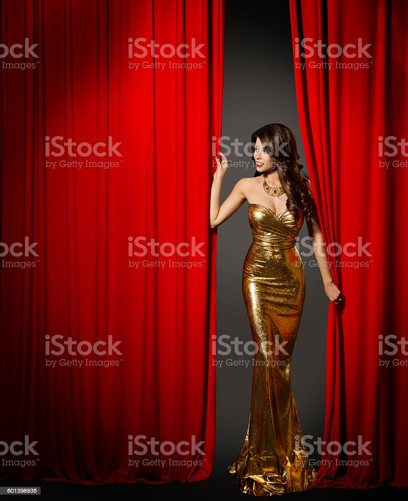 Actress Opening Red Cinema Curtain, Woman Elegant Gold Dress stock photo